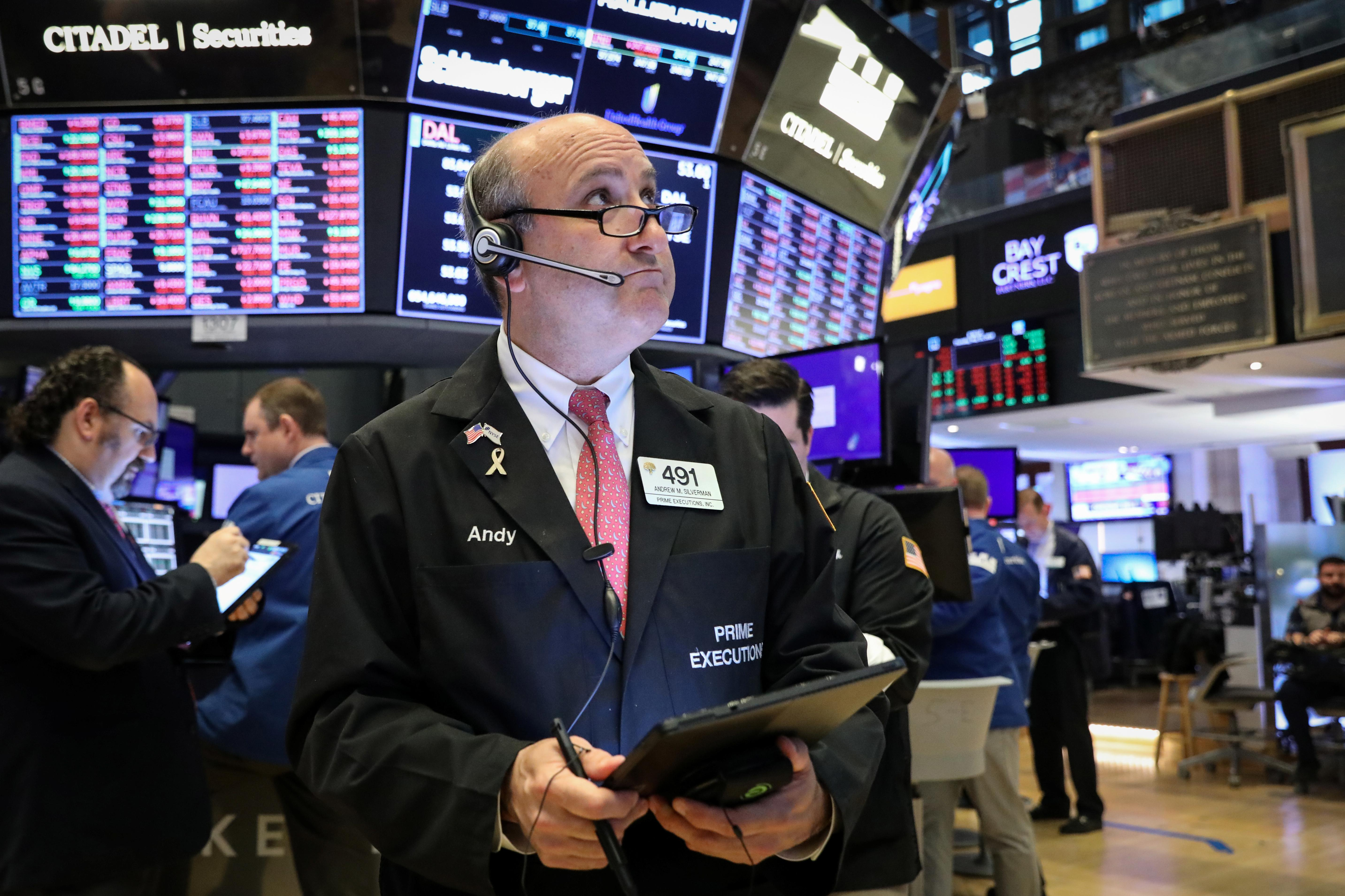 Wall St. slips; banks fall with prospect of rate cut, energy drops