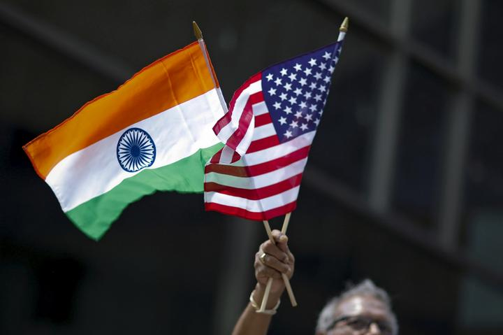 FILE PHOTO: Man holds the flags while people take part in the 35th India...