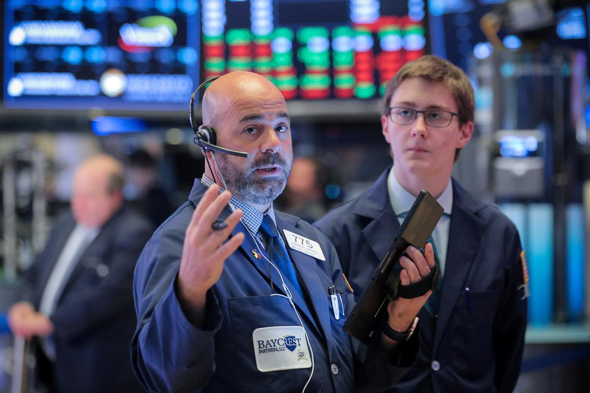 Wall St. dragged down by Iran tensions, trade worries; Fed in focus