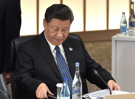 Xi tells Trump he hopes U.S. treats Chinese firms fairly