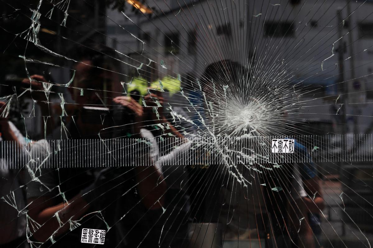 Hong Kong police tactics baffle the experts as legislature is trashed