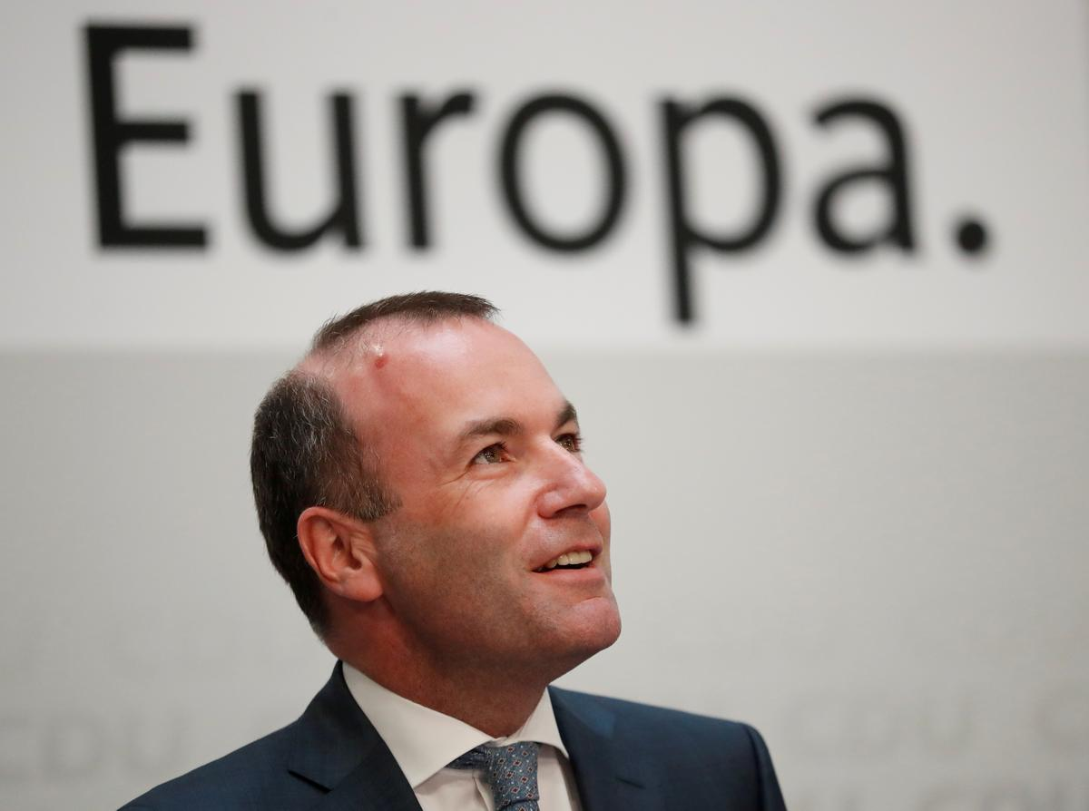 Center-right EU lawmaker says he will back socialist assembly head