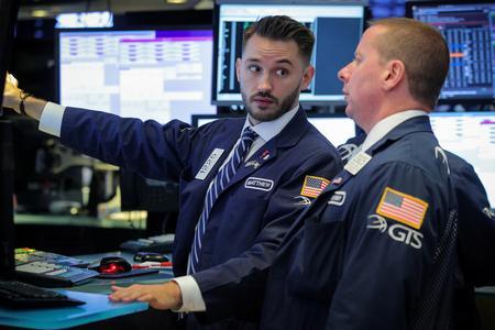 Major averages close at record highs on dovish Fed hopes
