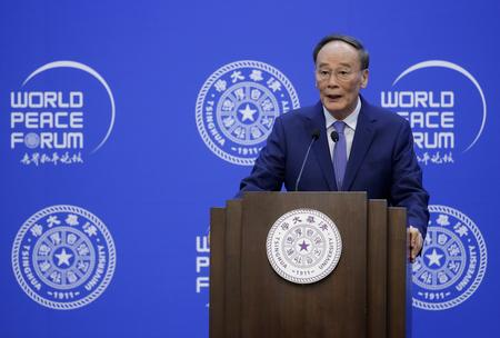 UPDATE 2-World cannot shut China out, vice president says, in jab at U.S.
