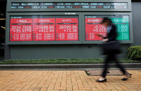 Asia stocks gain, dollar droops as Fed chair sets stage for rate cut