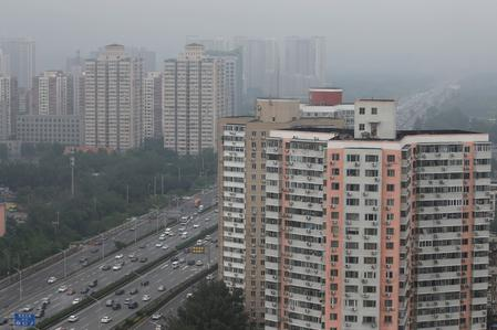 China home price growth cools in June, but investment quickens