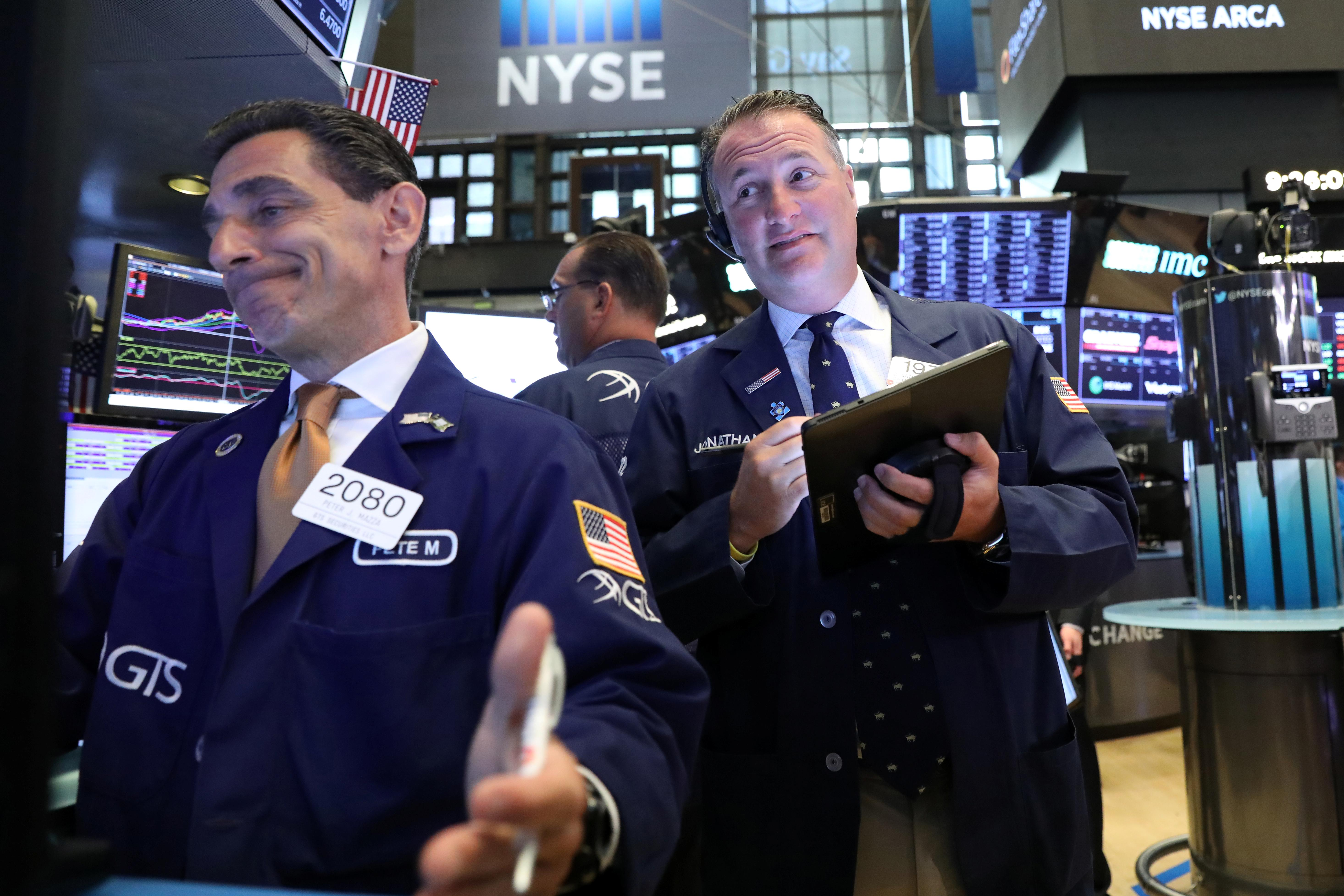 Wall Street slips after mixed bank earnings, Trump comments