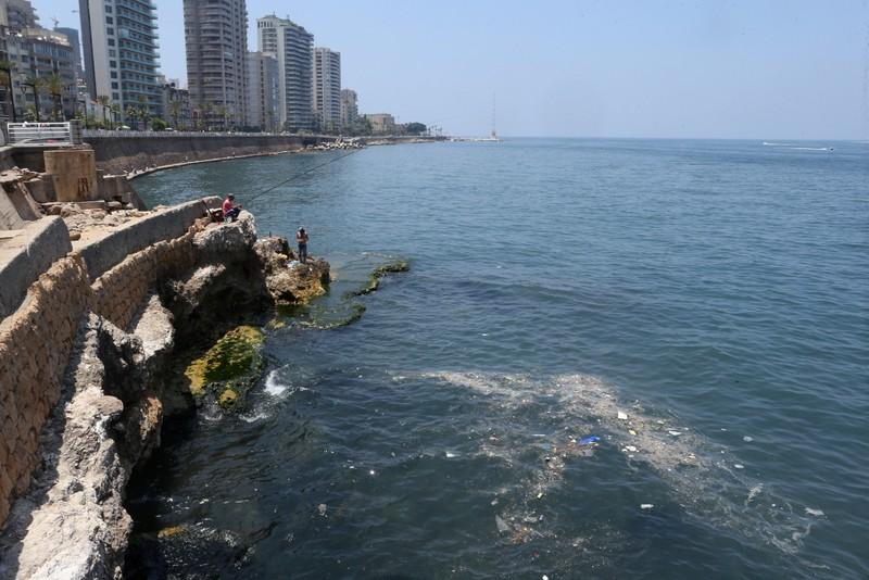 Lebanese brave badly polluted water to swim at public beaches