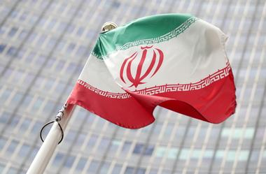 The Iranian flag flutters in front the International Atomic Energy Agency...