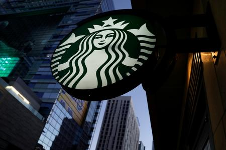 Starbucks raises profit view on U.S., China demand; shares near record