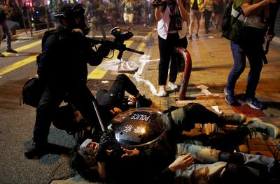 Protesters clash in Hong Kong as violence intensifies