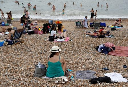 UK record-high temperature of 38.7C reached on July 25 - weather service