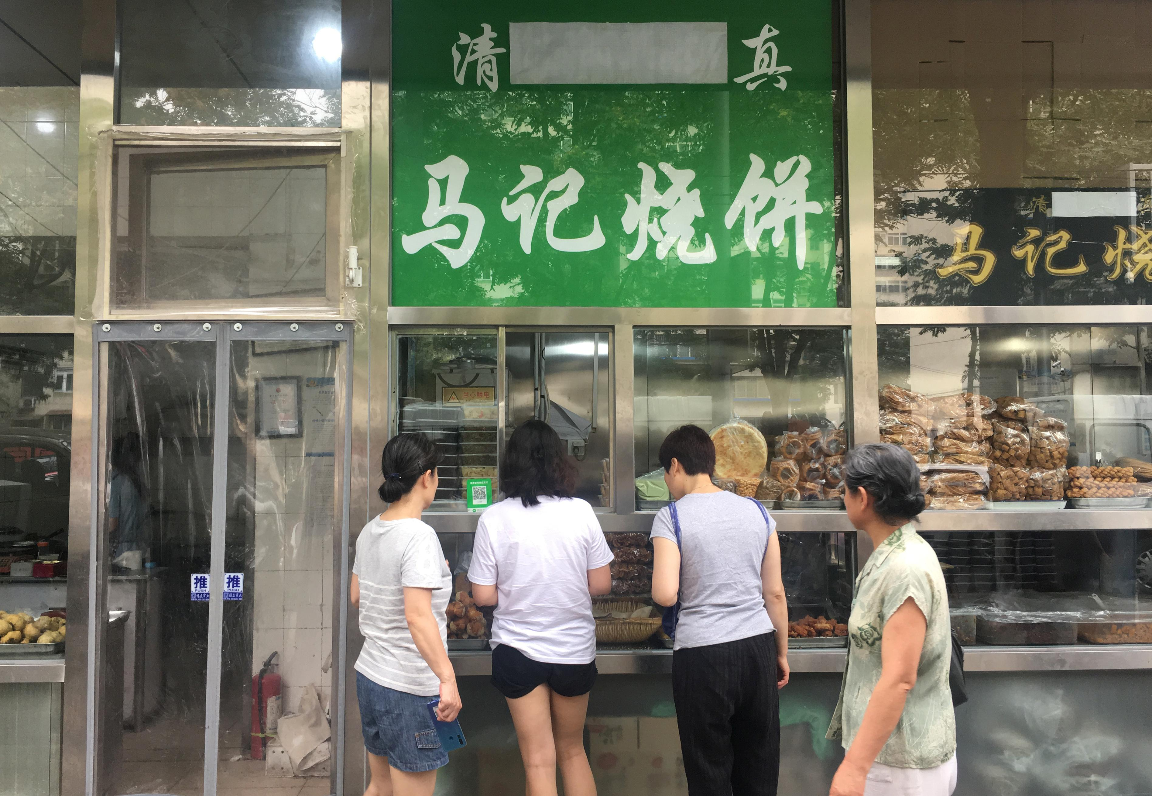Sign of the times: China's capital orders Arabic, Muslim symbols...