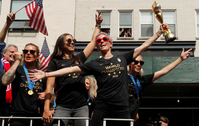FILE PHOTO: Soccer Football - Women's World Cup Champions Parade - New York, United States - July 10, 2019  Megan Rapinoe with the trophy during the parade  REUTERS/Mike Segar
