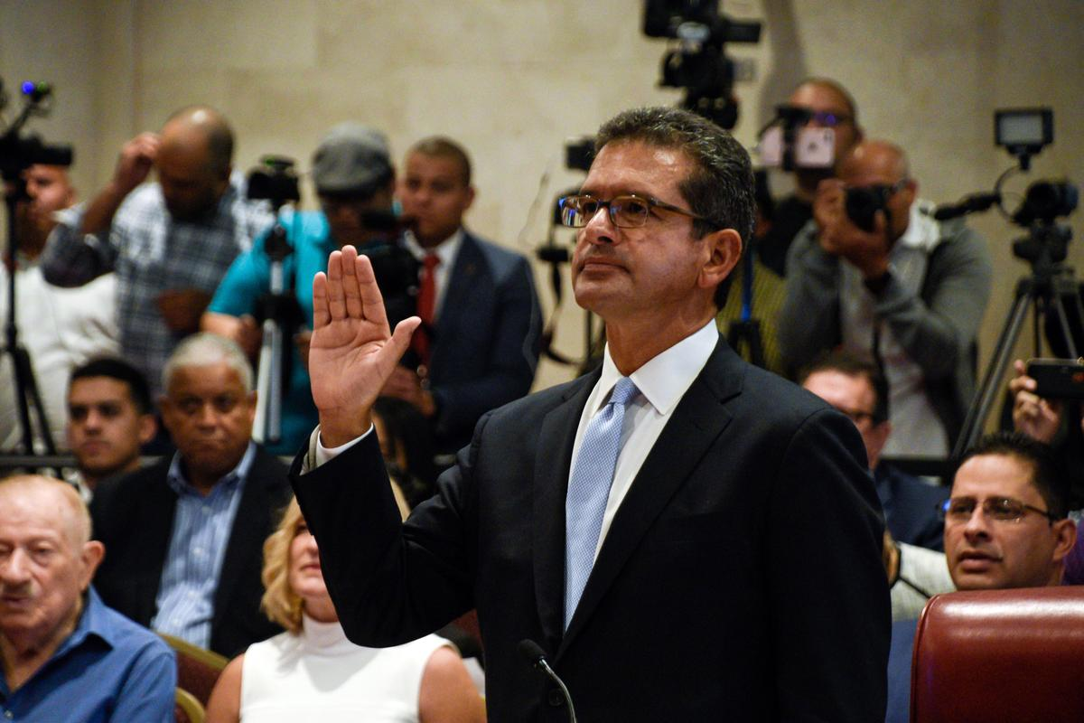 Puerto Rico governor swears in hand-picked successor; Senate leader outraged
