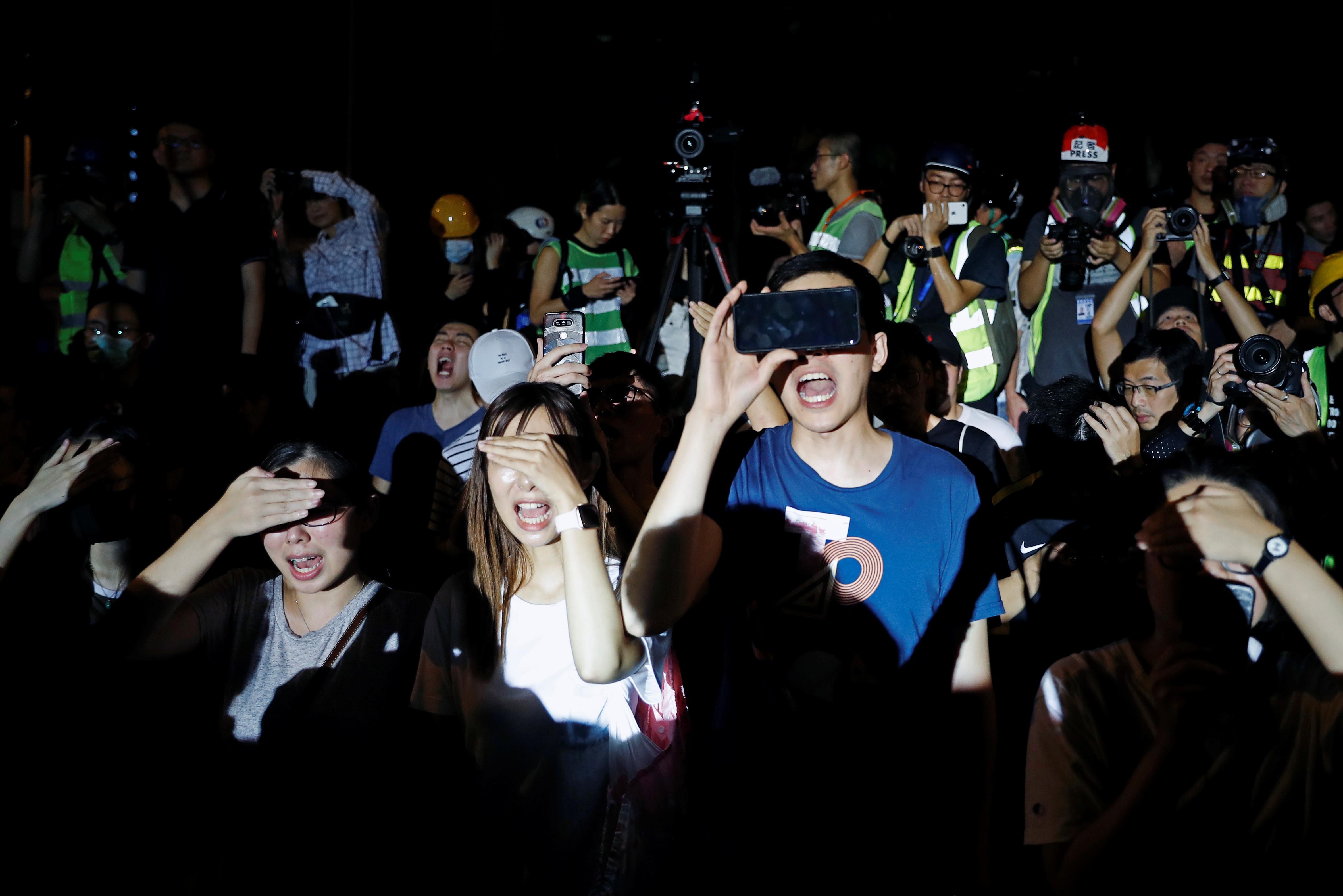 Thousands resume Hong Kong protests, China media warns Beijing won't 'sit idly by'
