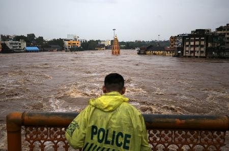 Hundreds stuck in India's financial capital Mumbai as heavy rain disrupts Mumbai rail service