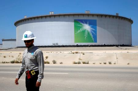 Saudi Aramco aims to buy Reliance stake, reports lower earnings