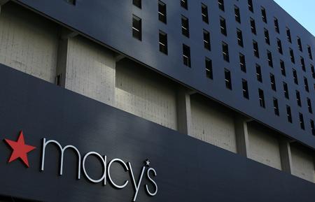 Macy's posts 48% drop in profit, cuts full-year forecast