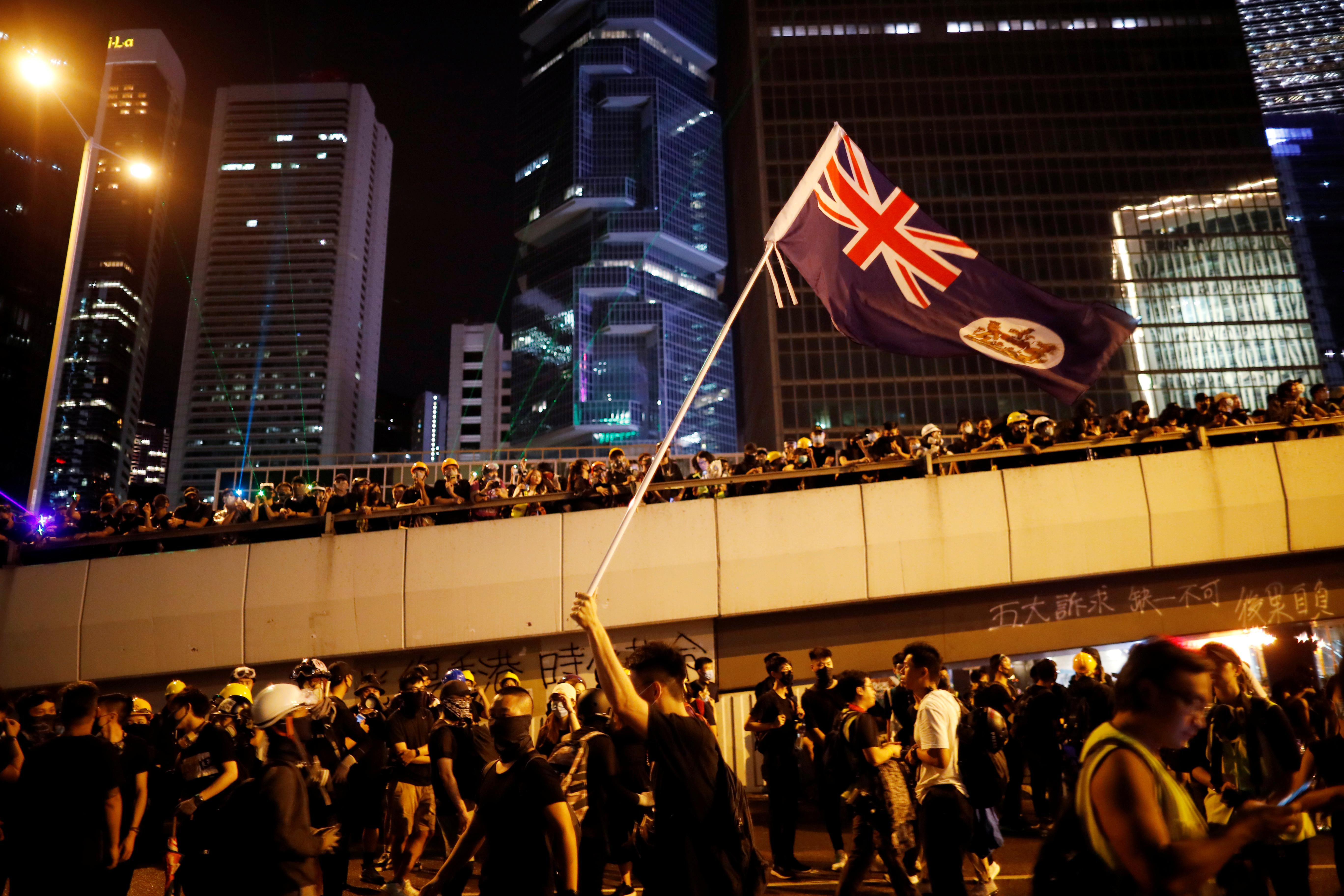 Hong Kong protesters throng streets peacefully in pouring rain