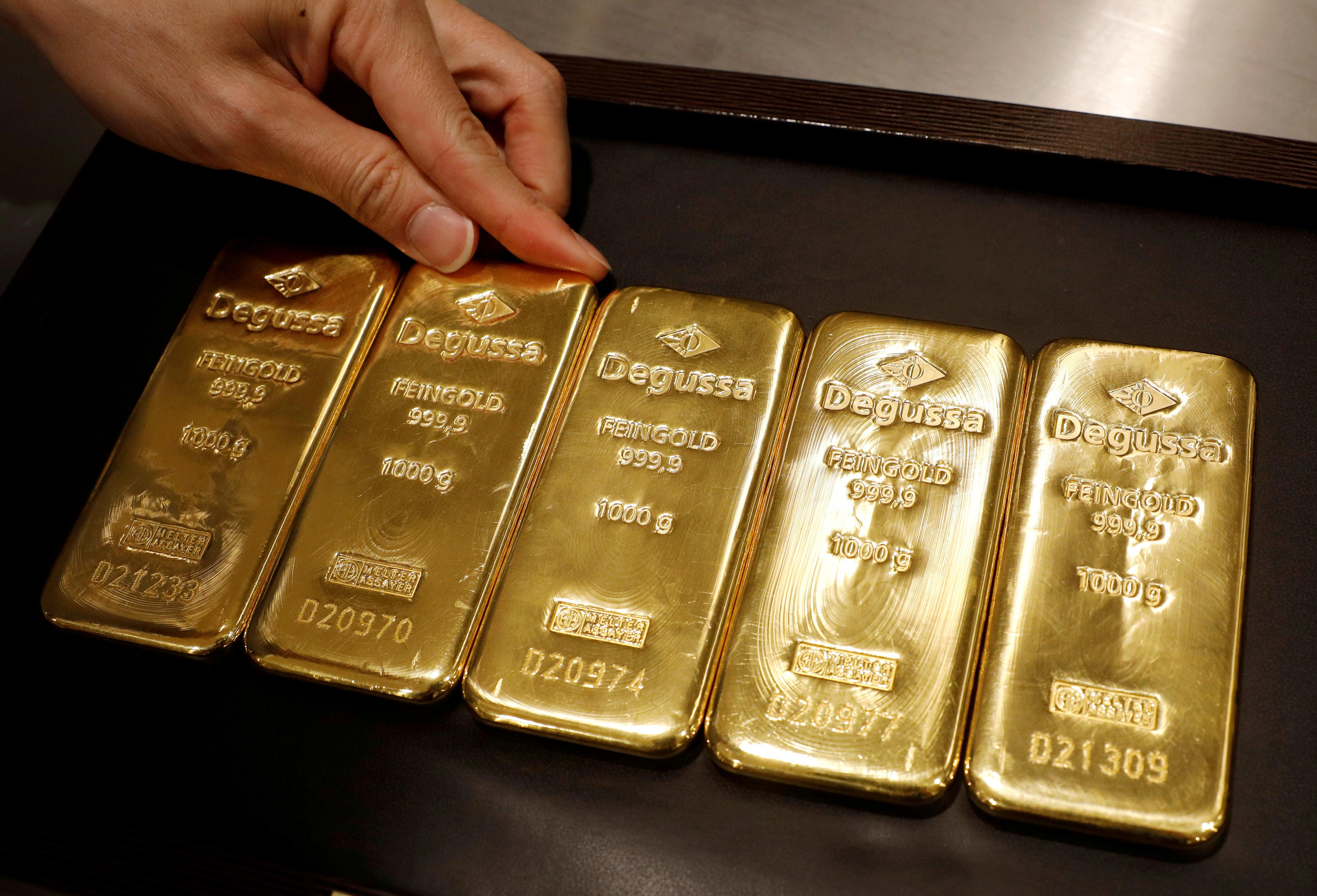 Gold prices dip on firmer dollar, equities