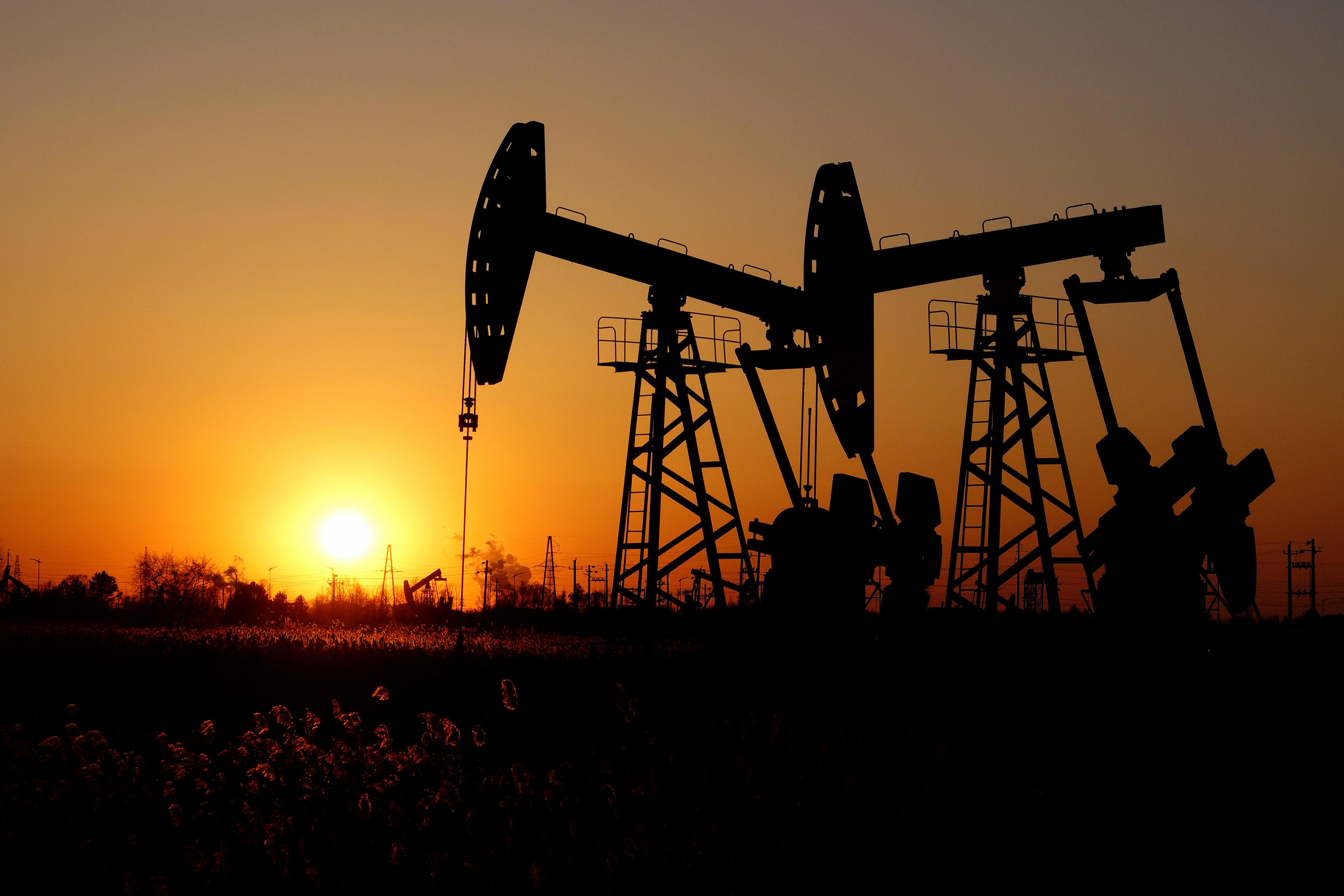 Oil up after drone attack on Saudi field, but OPEC report caps gains
