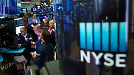 Wall Street rallies on stimulus cheer, trade optimism