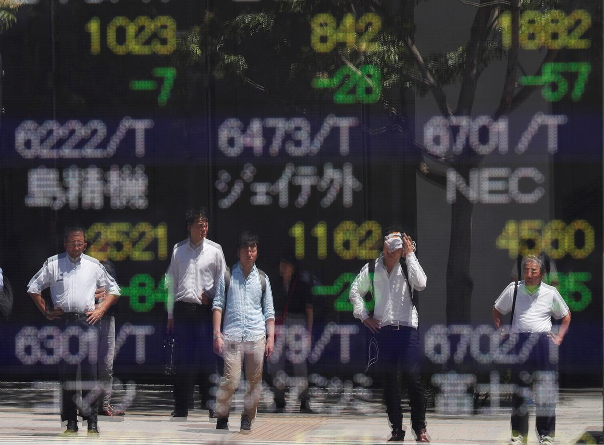 Asian shares nudge higher on stimulus hopes, recession fears ease