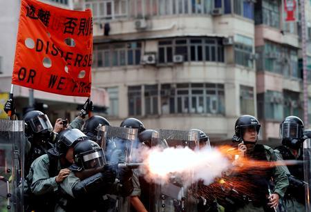 WRAPUP 2-Hong Kong banks condemn violence as jewellers seek to postpone trade fair