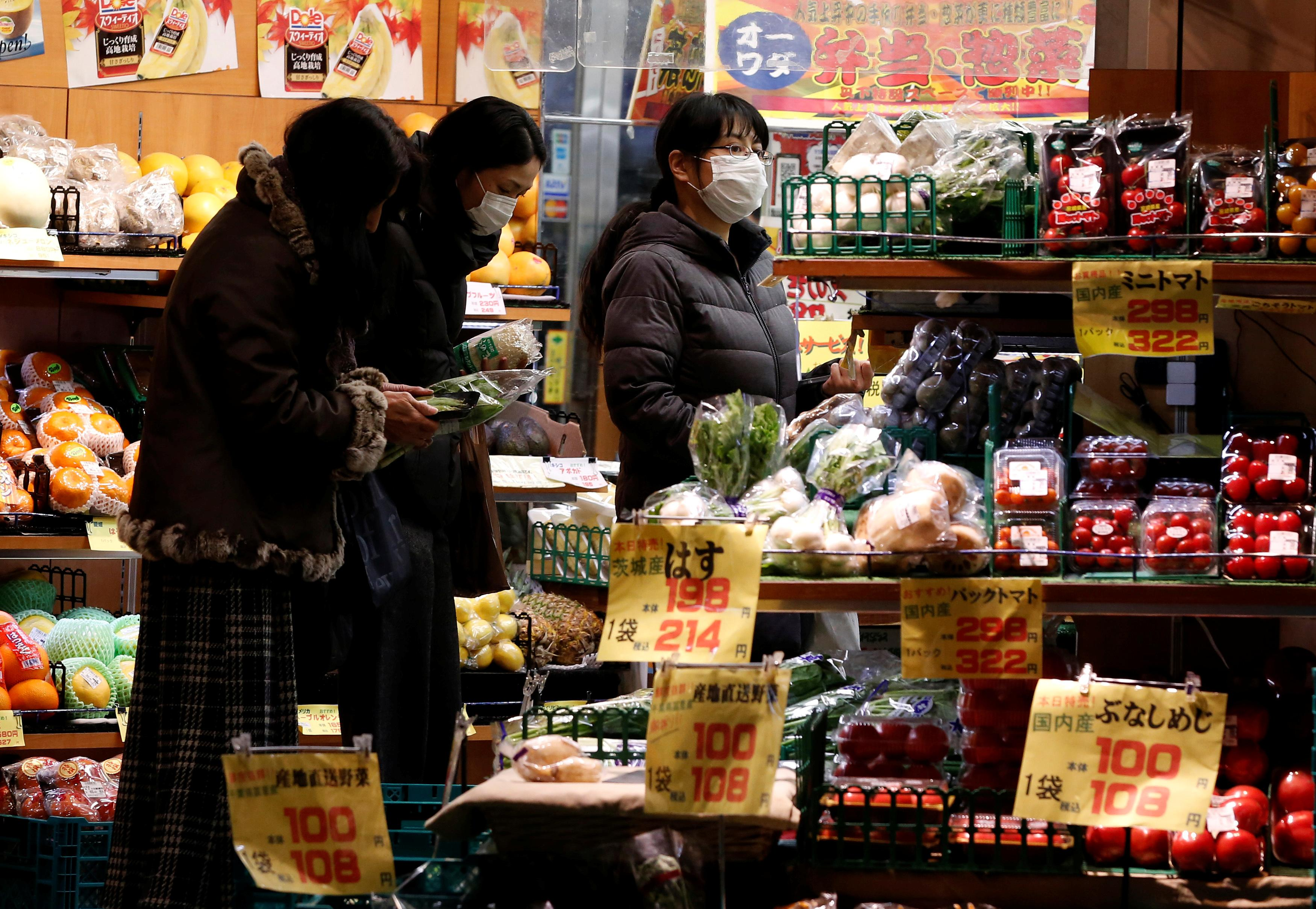 Japan's July core inflation hovers at two-year low, adds pressure on BOJ