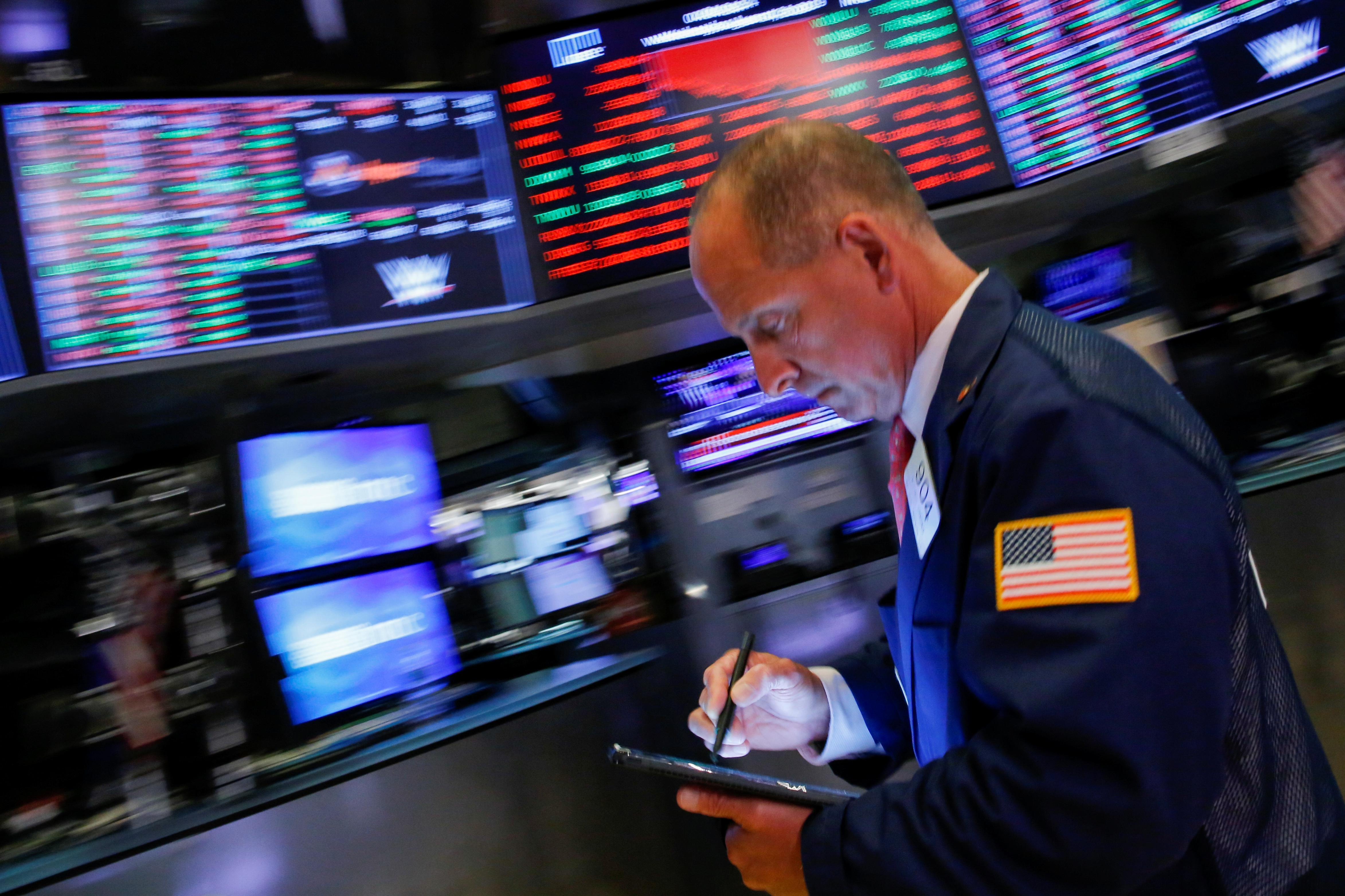 Stocks tumble, yen rallies as U.S. and China escalate trade war