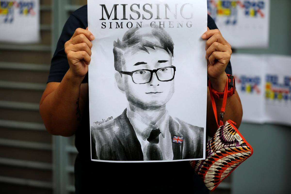 Employee of Britain's Hong Kong mission held in China released - police