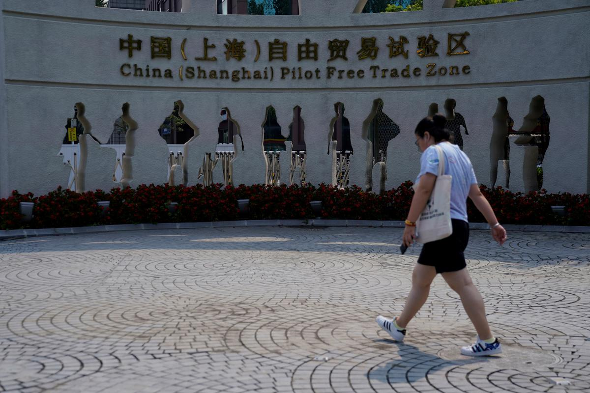 Banker exits, zombie accounts: China's Shanghai free trade zone sputters