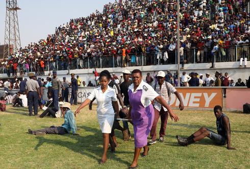 Mourners stampede as Zimbabwe's Robert Mugabe lies in state