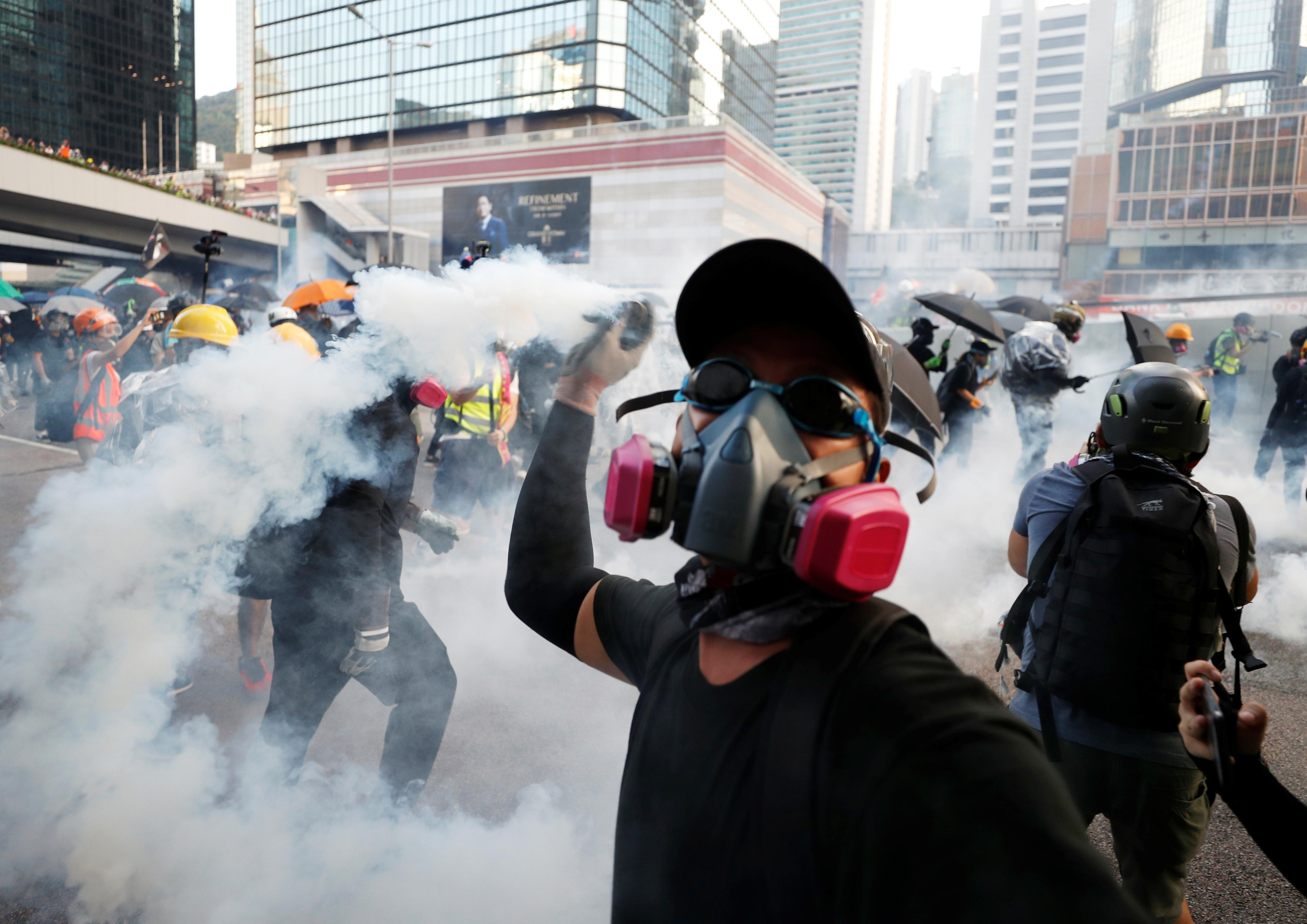 Hong Kong protesters hurl petrol bombs at government buildings in...