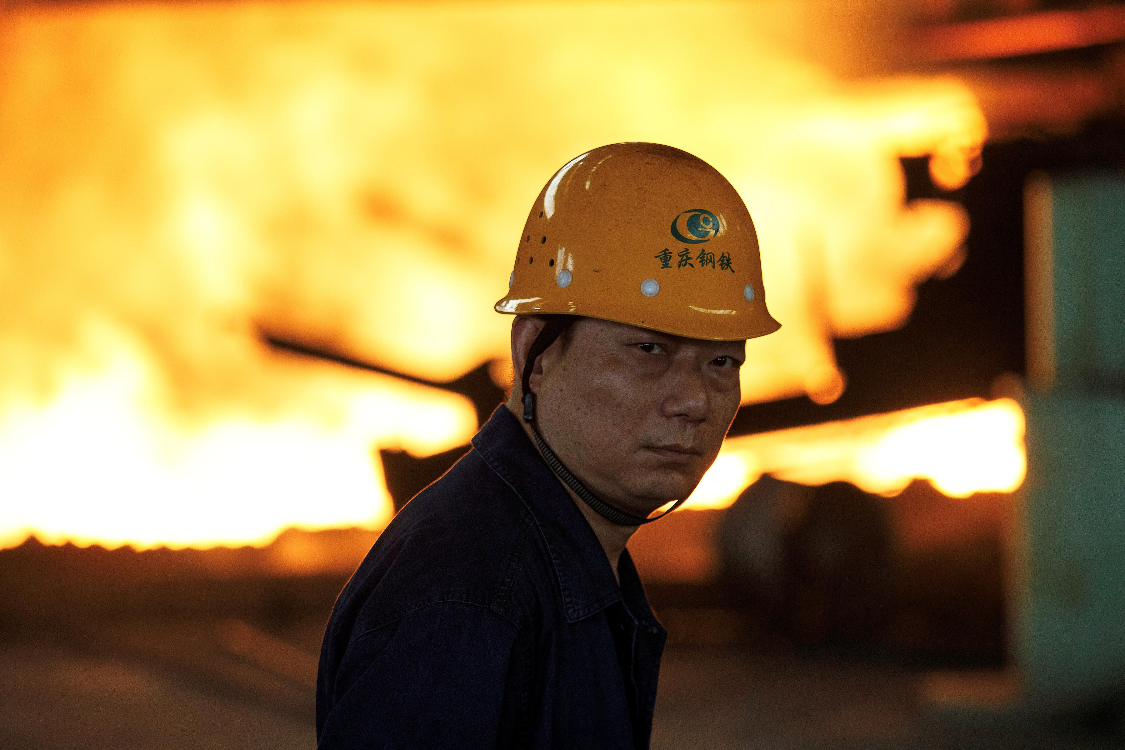 China's slowdown deepens; industrial output growth falls to 17-1/2...