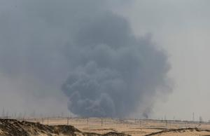 Smoke is seen following a fire at Aramco facility in the eastern city of...