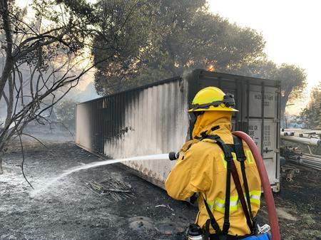 INSIGHT-Fire and hail push insurers to rethink climate change risks