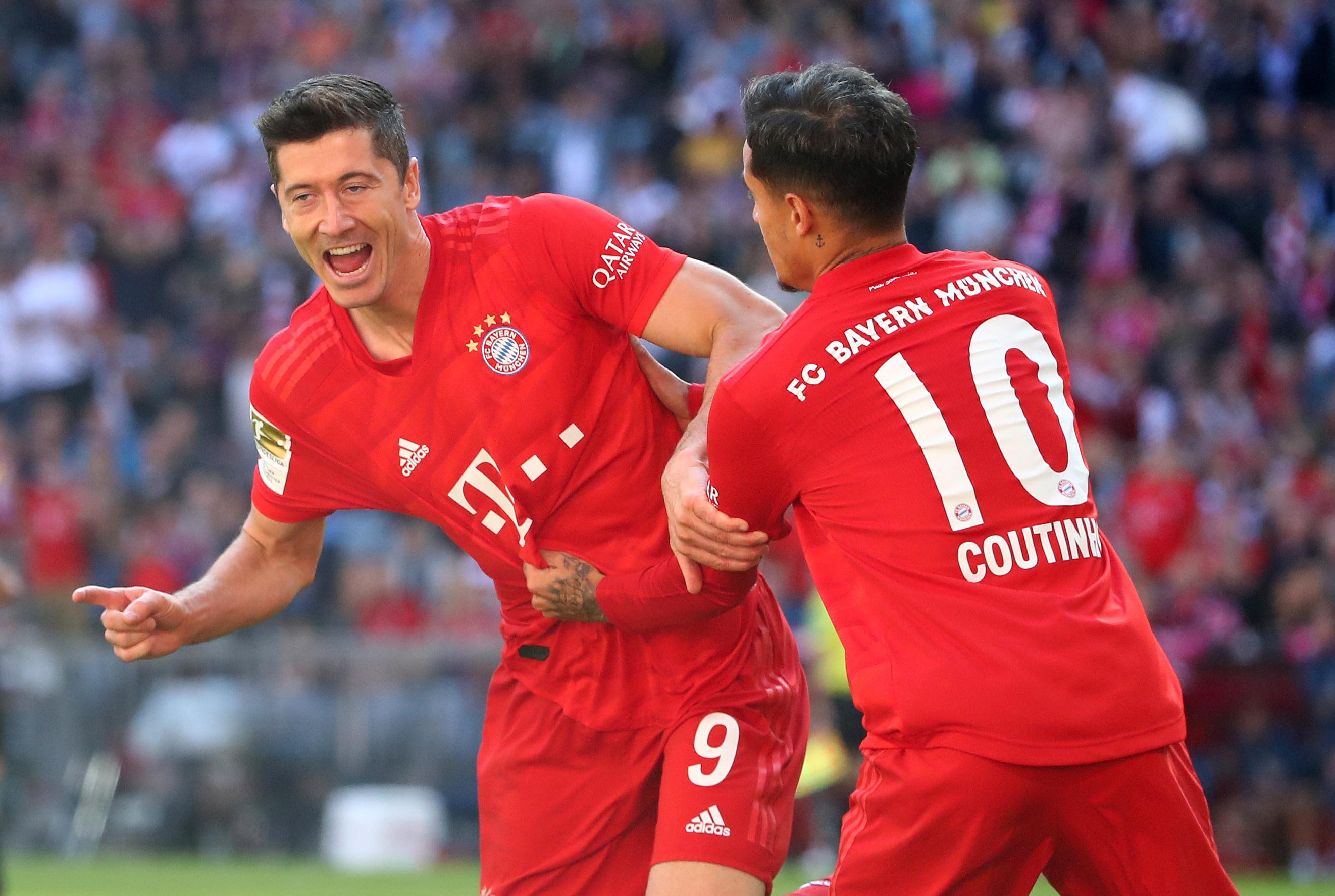 Lewandowski gets double and equals record as Bayern crush Cologne