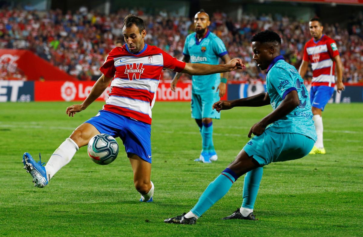 Granada stun dismal Barca to go top of La Liga