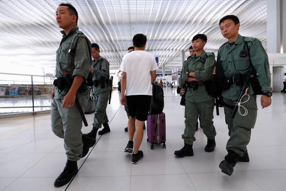 Hong Kong riot police curb airport protest after clashes