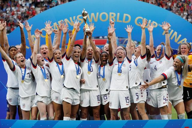 Soccer Football - Women's World Cup Final - United States v Netherlands - Groupama Stadium, Lyon, France - July 7, 2019  Carli Lloyd of the U.S. and team mates celebrate winning the women's world cup with the trophy     REUTERS/Bernadett Szabo