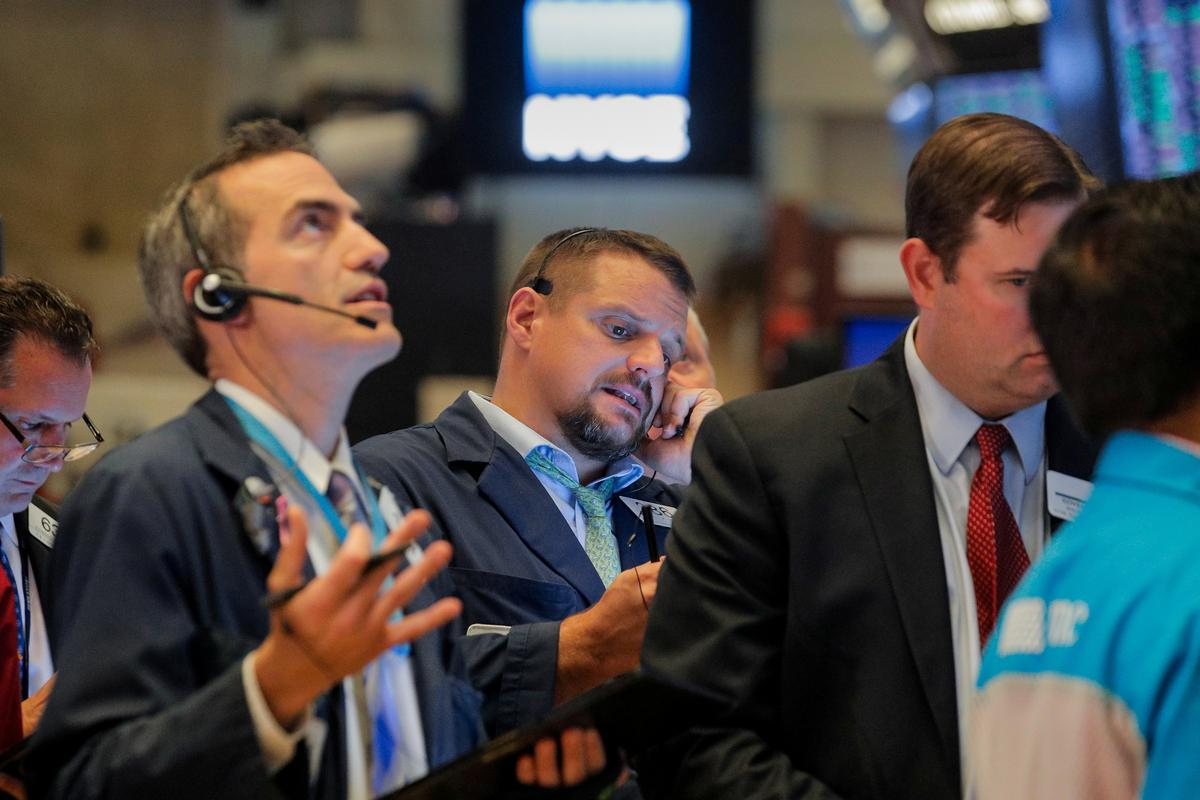 Wall Street cuts losses after Chinese foreign minister comment