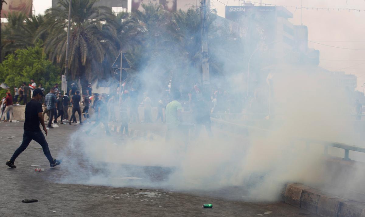 Die Irakse polisie open vuur, gebruik traangas en waterkanon om betogings in Bagdad te versprei