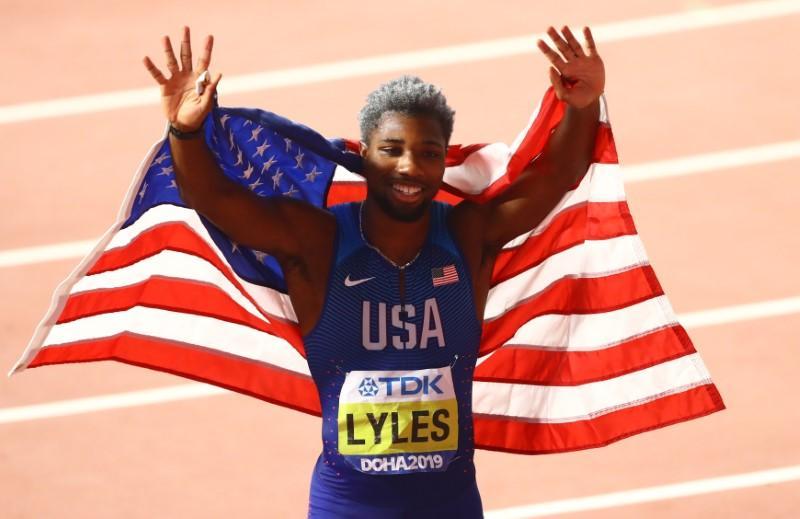 Athletics: Lyles brightens dark day with 200m gold