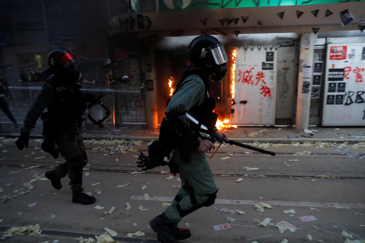 Police shoot teen protester as Hong Kong violence escalates