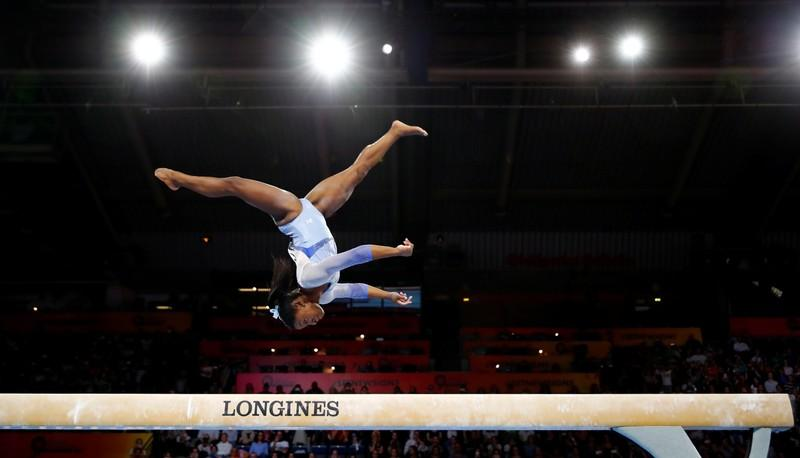 Biles lands new skills at worlds