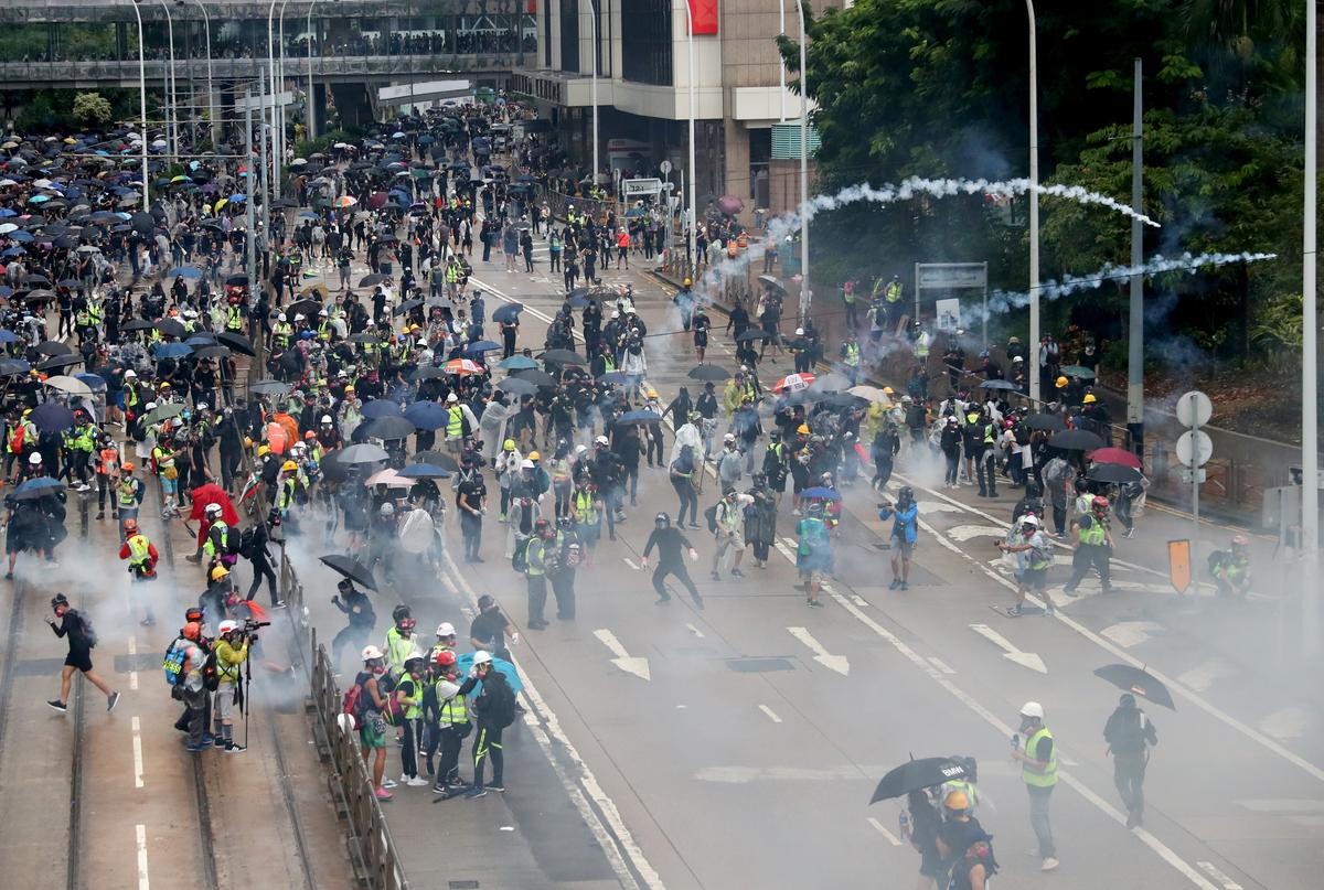Image result for Chinese soldiers in Hong Kong warn protesters as emergency rules fail to quell unrest