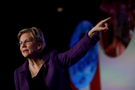 U.S. presidential candidate Warren calls on AT&T to reject plan she says will cost jobs