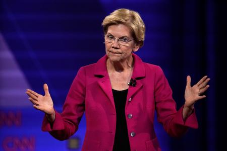 REFILE-Warren campaign challenges Facebook ad policy with 'false' Zuckerberg ad